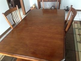 Oak mission style table and 4  chairs
