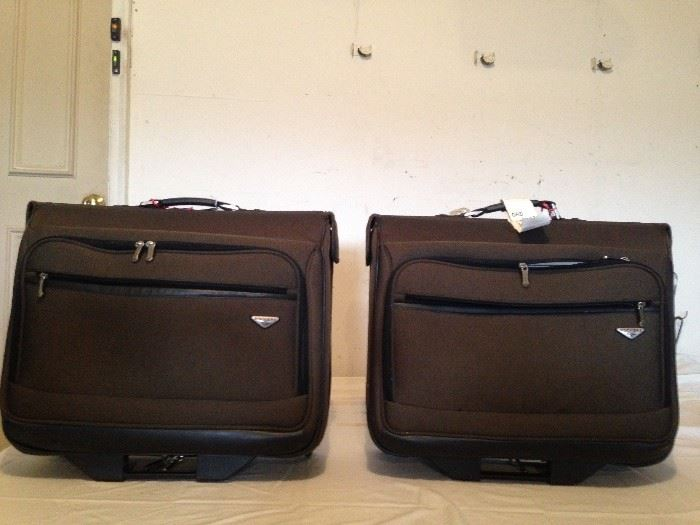 2 Large suit cases on wheels w/handles
