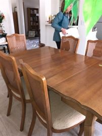 This dining table folds down to become a credenza type table.  It has 3 leaves, two of which are in and pads.