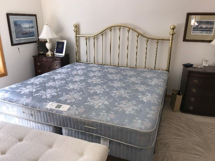 King size bed with brass headboard