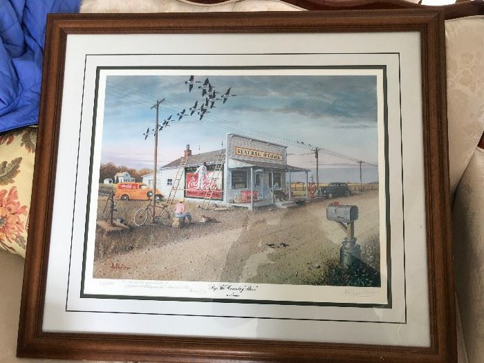 Les Kouba's well know and highly collectible framed and matted print  By the Country Store,  It is signed and numbered.