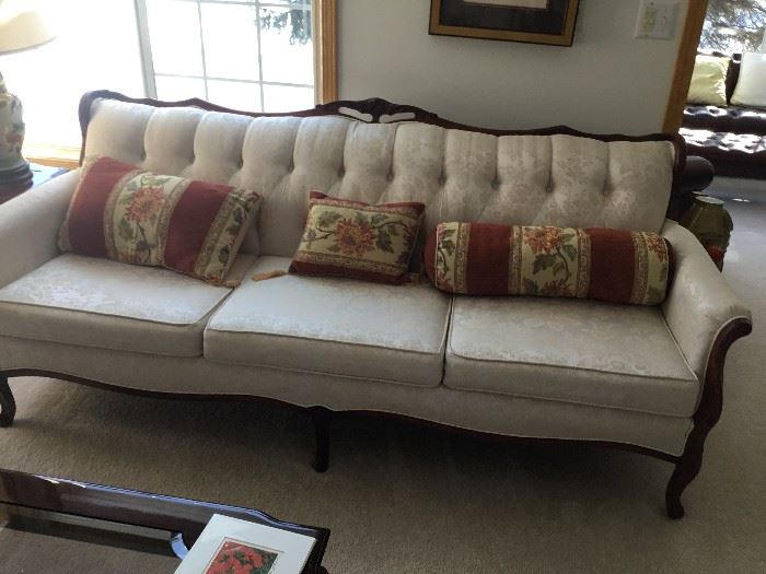 French Provincial style sofa with white brocade covering.  Excellent condition