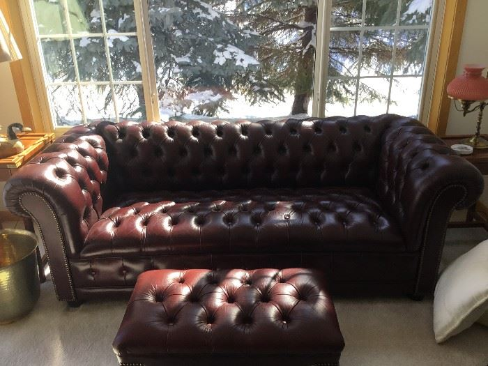 Leather Chesterfield sofa.  The footstool/coffee table matches both the sofa and wingback chair