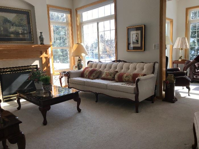 End tables, coffee table, pillows, pictures, lamps and decorative items