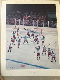 This is an artists proof of the print by Jerome Ryan and it is signed by Herb Brooks.  There is another signed and numbered print of this that is also autographed and is framed.  In addition, there is another lg framed hockey print by the same artist.  It is not autographed