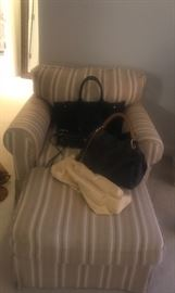 Chair is sold with the couch.  Tory Burch, Louis Vuitton and Rebecca Minkoff bags sold separately.