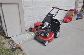2 Troy-Bilt Walk behind mowers, one with Honda engine, Sthil FS55R Trimmer