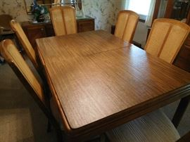 Table  is  a   Bernhardt  in   dining  room  There  are  pads and  leaves..