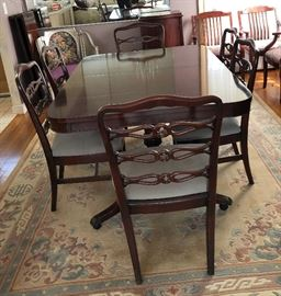beautiful mahogany finding room table with 6 chairs, buffet, & hutch