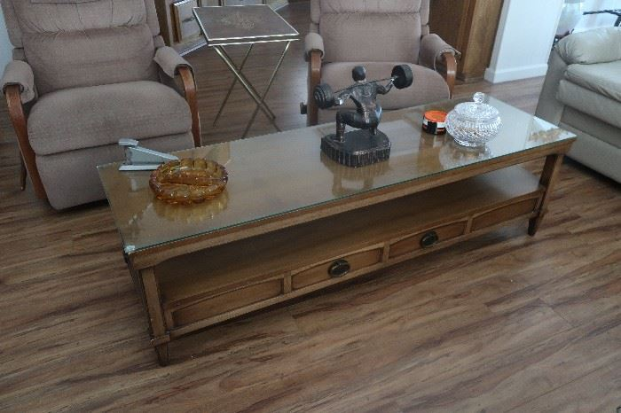 Coffee table and three matching end tables.