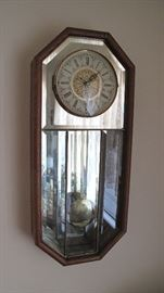 Mirrored wall clock.