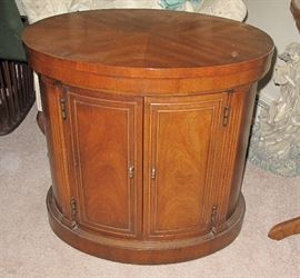 Quality oval two door cabinet.