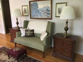 Sweet upholstered settee, pair of contemporary end tables by Pennsylvania House, Stiffel lamps and wall decor. Antique needlepoint footstool.