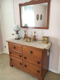 Vintage maple dresser and hanging mirror.