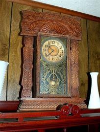 Antique gingerbread clock (glass door is cracked)