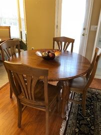 Hand Crafted, Oak Dining Room Table with 3 leaves, (Oval/Round), 6 light wood Dining Chairs