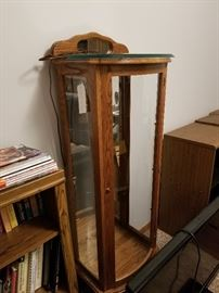 Tall Curio lighted and has 3 glass shelves