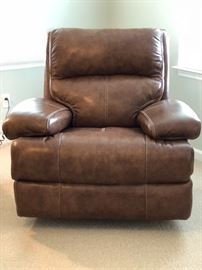 Faux leather recliner.