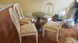 "$60   Round, glass table with brown pedestal  measures 42""   White chairs with plaid seats  $60 all four"