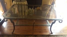 "$80    Glass table with gold trim metal base  measures 38"" x 56"""