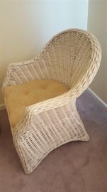 $60   White wicker chair and cushion