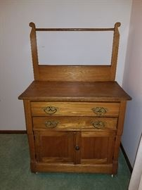 Vintage dresser/cabinet on wheels
