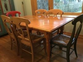 Farm table and 6 chairs with cane seats ,painted to add flair $550