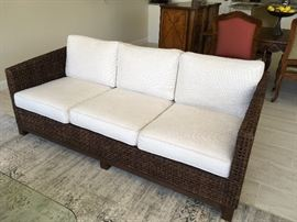 McGuire Rope Sofa. 78x36x 26; brand new white woven upholstery and cushions.  Two sofas available.  Always used inside but can be used outside.