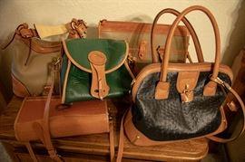 Dooney Bourke purses as new