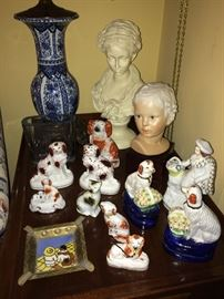 Staffordshire dogs throughout the condo; Cybis porcelain bust.