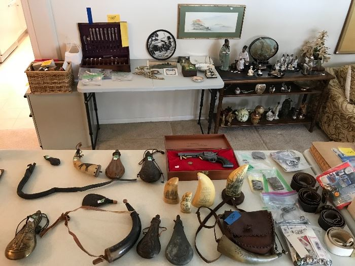 Various gun powder flasks and horns! Scrimshaw pieces. Military medals and Russian belts with buckles and misc different military buckles.