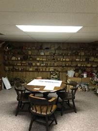 Wall shelves full of wicker baskets, boxes filled with good quality artificial flowers and greenery.   Heavy duty vintage round table with four chairs.  I framed Signed Maynard Reece painting.