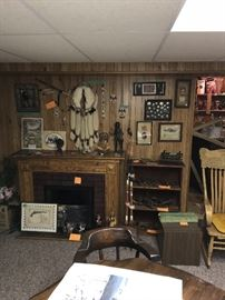Indian artifacts, western and military spurs, artificial  electric fireplace, antique rocker.