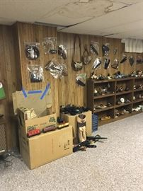 Lionel Train in box, misc leather gear for guns and knives on wall.  Zoom in on the shelves,  you will see wooden Duck and Fish carvings!  Some signed by the artist!