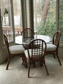 Glass top, Rattan table and four chairs!  Excellent condition and quality piece!