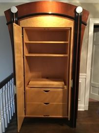 Inside of DAKOTA JACKSON armoire with pocket doors,  drawers,shelves and swivel stand to hide your flat screen!