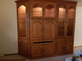 solid wood entertainment center with curio cabinets lighted glass via hinges
