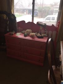 red dresser and matching head board