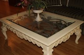 Large off white wood/glass and iron coffee table.