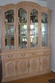 Nice light wood, mirrored china hutch.