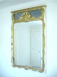 Large gold gilded hallway mirror.