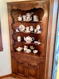 Circa Late 1800's Hand Carved Corner Curio with lots of pretty collectibles.