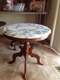 Antique Marble Top Table.  There are two other smaller Marble Top Tables behind it.