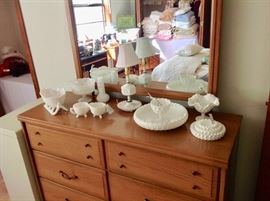 Milk Glass and some Fenton Glass sitting on a Mid-Century Dresser/Mirror