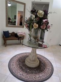 Entry pedestal table/circular glass top, Large Floral arragement,  Circular rug