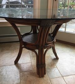 "29. Raymour & Flannigan Rattan and Bamboo Round Glass Top Dining Table (50""x 30"")"