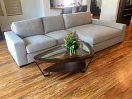 "Like brand new designer Bernhardt ""Orlando"" left arm chaise sofa.  Mid Century modern design soft triangular shaped coffee table."