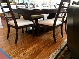 Arched base dining table profile shown