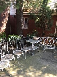 Set of iron patio furniture: Server,2 lounges, 2 Two seat couches ,6 chairs,Table, 4 arm chairs, 2 glass top end tables all with custom zippered (black and white)cushions.