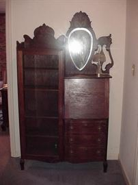 Beautiful Victorian bookshelf/display case with desk with drawers beneath. Mirror is beveled.